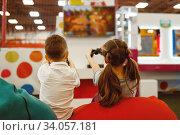 Купить «Children plays game console, entertainment center», фото № 34057181, снято 10 марта 2020 г. (c) Tryapitsyn Sergiy / Фотобанк Лори
