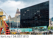 Купить «Liverpool, United Kingdom - April 26, 2019: Modern and classic architecture at the Liverpool Docks, Port of Liverpool, late on a cloudy afternoon», фото № 34057813, снято 26 апреля 2019 г. (c) age Fotostock / Фотобанк Лори