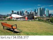 Купить «CALGARY, CANADA - AUGUST 5, 2019: Panoramic image of the skyline of Calgary with the Saddledom in the foreground on August 5, 2019 in Alberta, Canada», фото № 34058317, снято 5 августа 2019 г. (c) age Fotostock / Фотобанк Лори