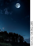 Купить «Moon and clouds in the night. Moonlight in the forest. Copy space background. Dark blue backdrop.», фото № 34062285, снято 5 июля 2020 г. (c) easy Fotostock / Фотобанк Лори