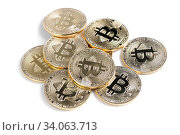 Macro view of shiny Bitcoin souvenire coins heap, isolated on white. Стоковое фото, фотограф Zoonar.com/Serghei Starus / easy Fotostock / Фотобанк Лори