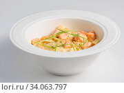 Fettuccine with salmon at white plate and background. Стоковое фото, фотограф Zoonar.com/Serghei Starus / easy Fotostock / Фотобанк Лори