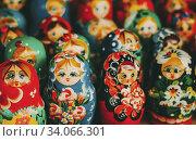 Купить «Colorful Russian nesting dolls matreshka at the market. Matrioshka Nesting dolls Babushka are the most popular souvenirs from Russia.», фото № 34066301, снято 18 августа 2013 г. (c) easy Fotostock / Фотобанк Лори