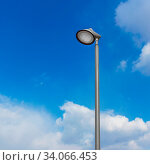 Купить «Lamppost against the sky. Led lamp for road with blue sky and cloud background.», фото № 34066453, снято 14 июля 2020 г. (c) easy Fotostock / Фотобанк Лори