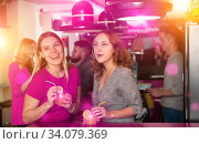 Happy positive females friends with cocktail in the club on party. Стоковое фото, фотограф Яков Филимонов / Фотобанк Лори