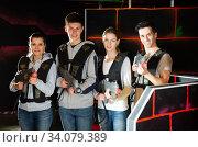 Confident young people with laser pistols. Стоковое фото, фотограф Яков Филимонов / Фотобанк Лори