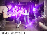 Women having fun on dark lasertag arena. Стоковое фото, фотограф Яков Филимонов / Фотобанк Лори