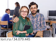 Female and male students working in computer room in library. Стоковое фото, фотограф Яков Филимонов / Фотобанк Лори