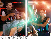 Cheerful Laser tag players playing in teams. Стоковое фото, фотограф Яков Филимонов / Фотобанк Лори