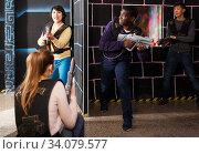 group of adult people with laser guns having fun. Стоковое фото, фотограф Яков Филимонов / Фотобанк Лори