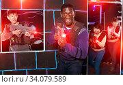 African man playing laser tag with friends. Стоковое фото, фотограф Яков Филимонов / Фотобанк Лори