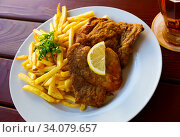 Pork chop with fried potato. Стоковое фото, фотограф Яков Филимонов / Фотобанк Лори
