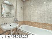 Small white tile bathroom with bath tube. Стоковое фото, фотограф Ольга Сапегина / Фотобанк Лори