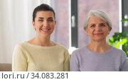 Купить «smiling senior mother with adult daughter at home», видеоролик № 34083281, снято 8 июня 2020 г. (c) Syda Productions / Фотобанк Лори