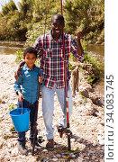 Man and boy with bucket of catch. Стоковое фото, фотограф Яков Филимонов / Фотобанк Лори