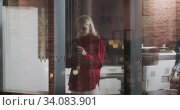 Купить «Professional businesswoman using a digital tablet while standing in modern office in slow motion», видеоролик № 34083901, снято 27 февраля 2020 г. (c) Wavebreak Media / Фотобанк Лори