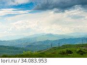 Купить «Beautiful panoramic view of the picturesque mountains and fields of Armenia on a sunny summer day», фото № 34083953, снято 8 июня 2018 г. (c) Константин Лабунский / Фотобанк Лори