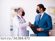Купить «Young businessman meeting with old doctor», фото № 34084473, снято 4 февраля 2020 г. (c) Elnur / Фотобанк Лори