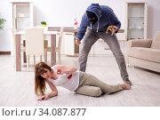 Купить «Gangster and young woman in robbery concept», фото № 34087877, снято 15 мая 2019 г. (c) Elnur / Фотобанк Лори