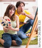 Купить «Young couple enjoying painting at home», фото № 34088133, снято 11 июля 2018 г. (c) Elnur / Фотобанк Лори