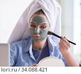 Купить «Woman applying clay mask with brush at home», фото № 34088421, снято 29 января 2018 г. (c) Elnur / Фотобанк Лори
