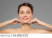 Купить «beautiful young woman touching her face and chin», фото № 34088633, снято 30 ноября 2019 г. (c) Syda Productions / Фотобанк Лори