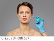 beautiful young woman and hand with syringe. Стоковое фото, фотограф Syda Productions / Фотобанк Лори