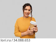 smiling woman with pierced nose holding coffee cup. Стоковое фото, фотограф Syda Productions / Фотобанк Лори