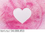 Купить «heart shape on pink glitters on white background», фото № 34088853, снято 4 декабря 2019 г. (c) Syda Productions / Фотобанк Лори