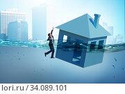 Купить «Mortgage repayment failure concept with man», фото № 34089101, снято 10 июля 2020 г. (c) Elnur / Фотобанк Лори