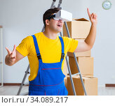 Купить «Painter contractor working with virtual reality goggles», фото № 34089217, снято 23 мая 2017 г. (c) Elnur / Фотобанк Лори