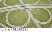 Panoramic aerial view of road junction in Russia from drone at sunny day. Стоковое видео, видеограф Яков Филимонов / Фотобанк Лори