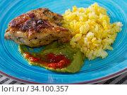 Купить «Fried chicken thighs with rice», фото № 34100357, снято 5 августа 2020 г. (c) Яков Филимонов / Фотобанк Лори