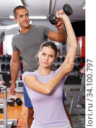 Woman and trainer doing exercises with dumbbells with. Стоковое фото, фотограф Яков Филимонов / Фотобанк Лори