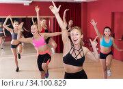 Купить «Cheerful females exercising dance moves», фото № 34100829, снято 31 мая 2017 г. (c) Яков Филимонов / Фотобанк Лори