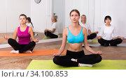 Women exercising yoga poses in fitness center. Стоковое фото, фотограф Яков Филимонов / Фотобанк Лори
