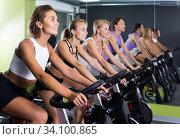 women on cardio training on exercycles in health club. Стоковое фото, фотограф Яков Филимонов / Фотобанк Лори