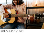 Купить «Woman sitting on the floor and play the guitar», фото № 34101581, снято 20 июня 2020 г. (c) Tryapitsyn Sergiy / Фотобанк Лори