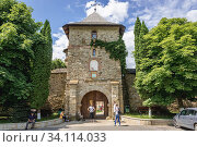 Gate tower of Moldovita Monastery - Romanian Orthodox monastery located in commune of Vatra Moldovitei, Suceava County, Romania. Стоковое фото, фотограф Konrad Zelazowski / age Fotostock / Фотобанк Лори