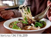 Niu rou mian, Taiwan famous snack of beef noodles. Стоковое фото, фотограф Zoonar.com/Chen PengGuang / easy Fotostock / Фотобанк Лори