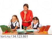 Купить «The student asked the teacher a question, the teacher looks at the book in disbelief», фото № 34123861, снято 10 июля 2020 г. (c) easy Fotostock / Фотобанк Лори