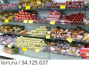 Russia Samara March 2020: Selection of sausages at the Traffic Light store in the gastronomic department of semi-finished products. Text in Russian: Traffic light. Редакционное фото, фотограф Акиньшин Владимир / Фотобанк Лори