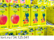 Russia Samara March 2020: Sale of packaged juices in a supermarket. Text in Russian: guest multifruit juice liter. Редакционное фото, фотограф Акиньшин Владимир / Фотобанк Лори