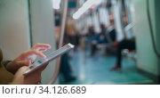 Купить «Entertainment with pad during underground travel», фото № 34126689, снято 13 июля 2020 г. (c) Данил Руденко / Фотобанк Лори