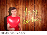 Happy young man in polo with baloons celebrates his birthday. Стоковое фото, фотограф Zoonar.com/Kotin Dmitrii / age Fotostock / Фотобанк Лори