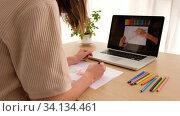 Купить «Crop unrecognizable illustrator drawing using laptop with video tutorial», видеоролик № 34134461, снято 25 июня 2020 г. (c) Ekaterina Demidova / Фотобанк Лори