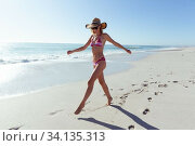 Купить «Beautiful woman walking on the beach», фото № 34135313, снято 25 февраля 2020 г. (c) Wavebreak Media / Фотобанк Лори