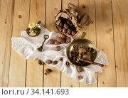 Купить «Still life with walnuts, vintage nutcracker, a candle on a table close-up», фото № 34141693, снято 19 января 2017 г. (c) Татьяна Ляпи / Фотобанк Лори