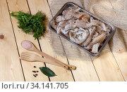 Fresh Cancers-mantis in the tray on a wooden table close-up. Стоковое фото, фотограф Татьяна Ляпи / Фотобанк Лори