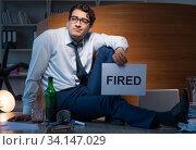 Купить «Employee fired during crisis drinking in stress and despair», фото № 34147029, снято 14 октября 2017 г. (c) Elnur / Фотобанк Лори
